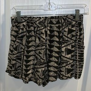black and cream patterned fabric shorts